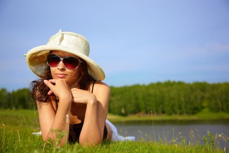 Girl in sun hat in nature photo