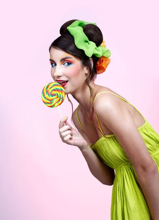 portrait of beautiful girl with big lollipop photo