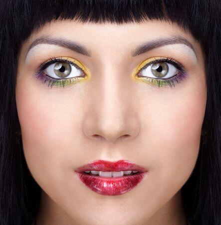 half face portrait of beautiful brunette girl photo