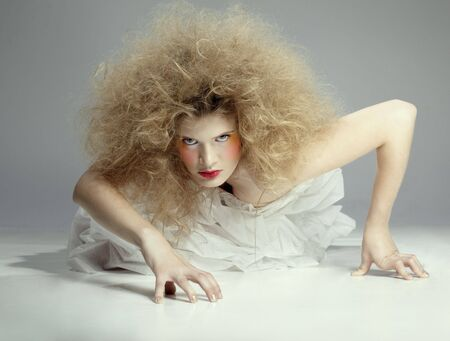 portrait of caucasian girl with girl with shock hair-do crawling Stock Photo - 6090609