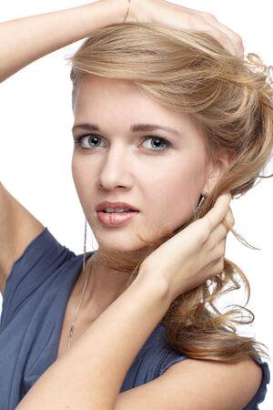 portrait of beautiful blonde blue-eyed girl photo