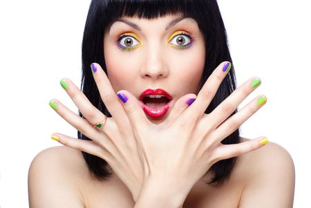 portrait of beautiful brunette girl shows her finger-nail make up photo