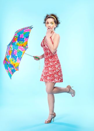 portrait of beautiful slavonic girl posing with big colorful umbrella Stock Photo - 6310045