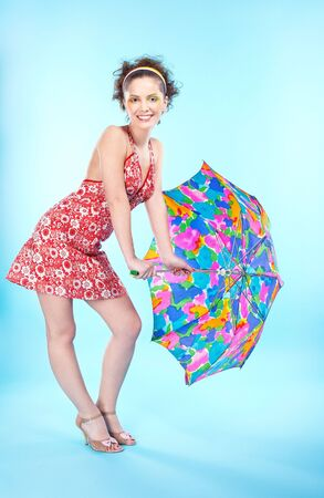 portrait of beautiful slavonic girl posing with big colorful umbrella photo