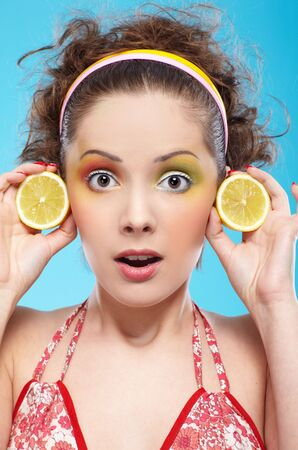portrait of beautiful slavonic girl posing with lemon photo