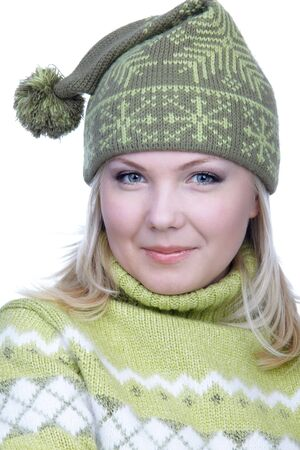 slavonic: portrait of beautiful slavonic blonde girl in green sweater and winter cap with bob