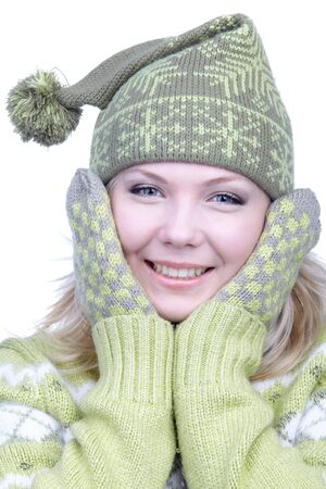 portrait of beautiful dreamy blonde girl in green sweater, mittens and winter cap with bob photo