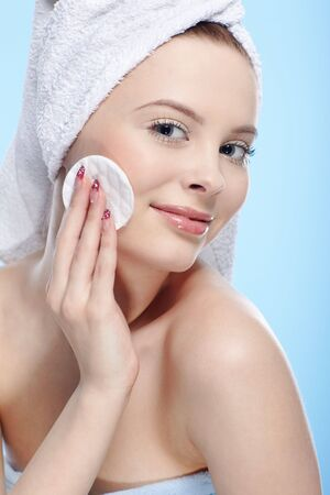 beautiful healthy serene girl with cotton pad