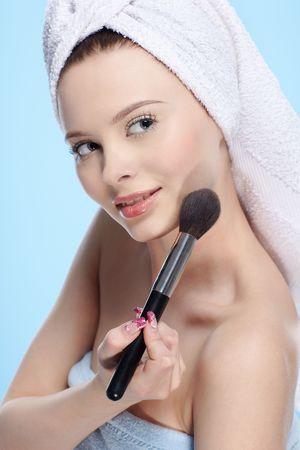 beautiful healthy girl with powder brush photo
