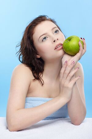 beautiful healthy serene girl with green apple photo