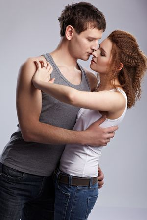 portrait of young caucasian couple on gray Stock Photo - 6517975
