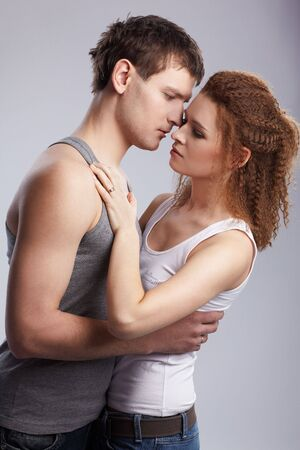 portrait of young caucasian couple on gray Stock Photo - 6517959