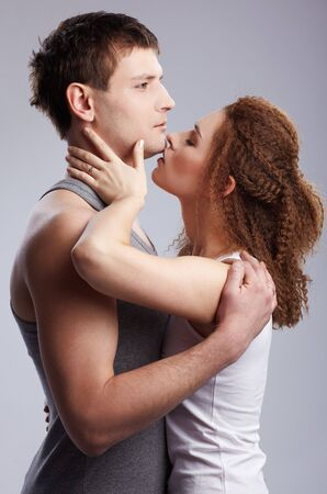 portrait of young caucasian couple on gray Stock Photo - 6517943