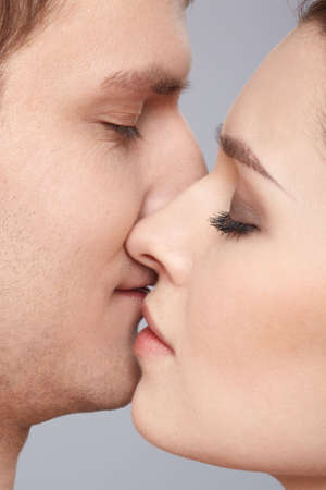 close up portrait of young caucasian couple kissing Stock Photo - 6517947