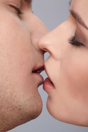 close up portrait of young caucasian couple kissing Stock Photo - 6517934
