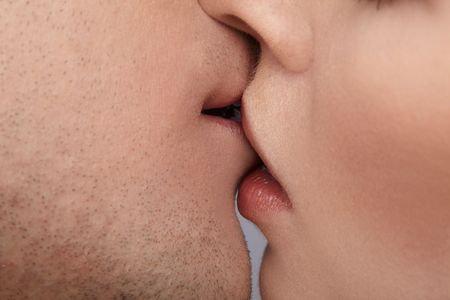 close up portrait of young caucasian couple kissing Stock Photo - 6517927
