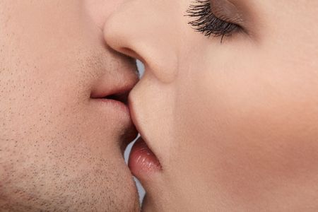 close up portrait of young caucasian couple kissing Stock Photo
