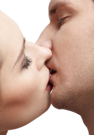 close up portrait of young caucasian couple kissing Stock Photo - 6517935