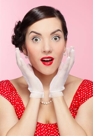 pin-up style portrait of beautiful brunette girl posing in white gloves photo