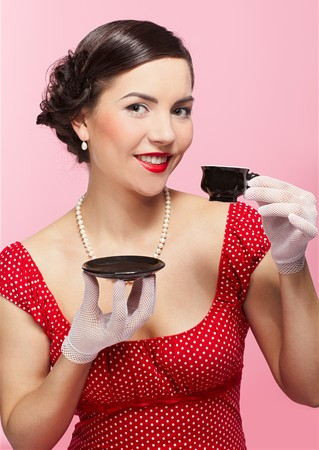 pin-up style portrait of beautiful brunette girl with tea cup Stock Photo - 7041811