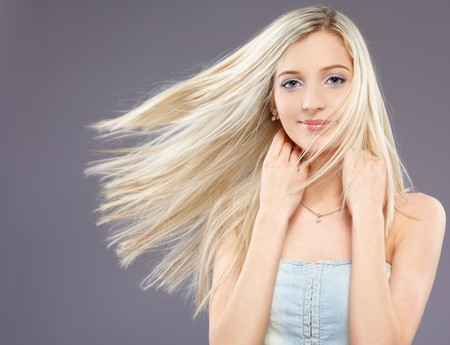 fluttering: portrait of beautiful slavonic blonde girl with fluttering hair Stock Photo
