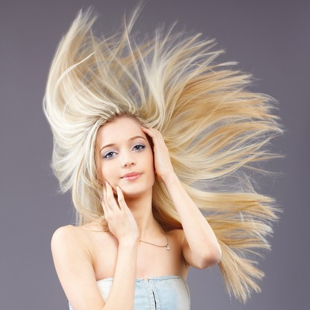 gray hair: portrait of beautiful slavonic blonde girl with fluttering hair Stock Photo