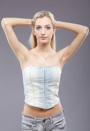 armpit hair: portrait of beautiful slavonic blonde girl touching her hair Stock Photo