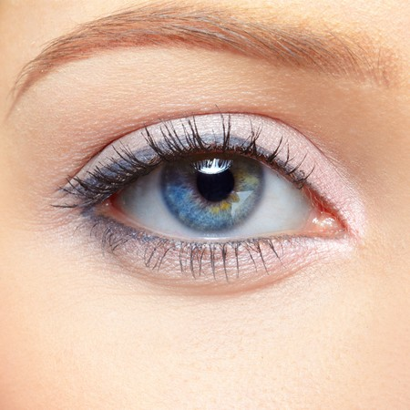 female face closeup: closeup eye-zone portrait of beautiful blonde girl Stock Photo