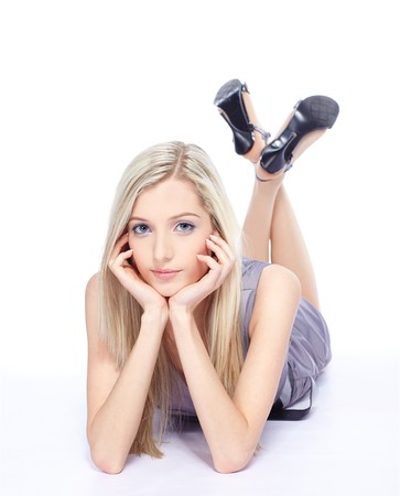 shoes model: full-length portrait of beautiful slavonic blonde girl posing on white