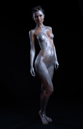 portrait of nude girl body painted with silver posing on black Stock Photo - 7092619