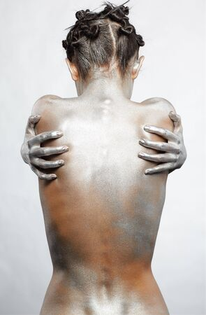 nude art model: portrait of nude girls back painted with silver