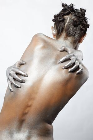 portrait of nude girl's back painted with silver Stock Photo - 7096075