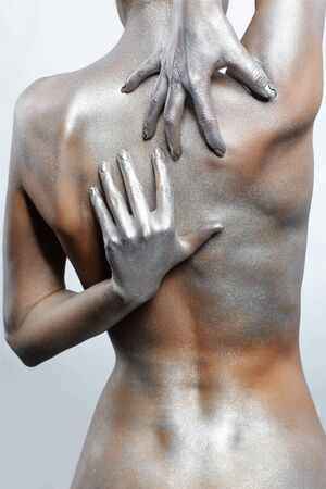 portrait of nude girl's back painted with silver Stock Photo - 7096070