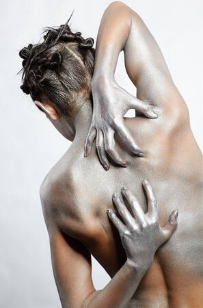 portrait of nude girl's back painted with silver Stock Photo - 7096071