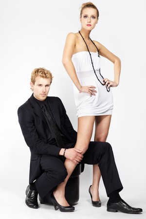 portrait of well-dressed blonde couple on gray. photo