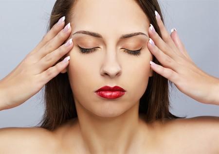 portrait of brunette girl touching her head like she has headache photo