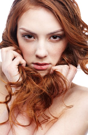 redhead: portrait of freckled dark red-haired girl Stock Photo