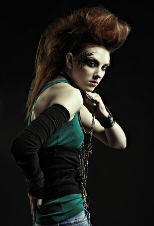 portrait of glam punk redhead girl photo