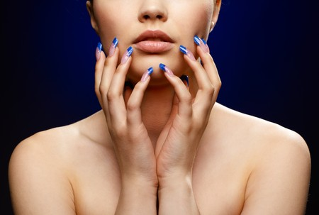 nail studio: Close-up portrait of girl with blue manicure Stock Photo