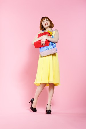 portrait of redhead woman posing on pink Stock Photo - 7368569