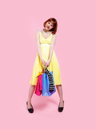 portrait of redhead woman posing on pink photo