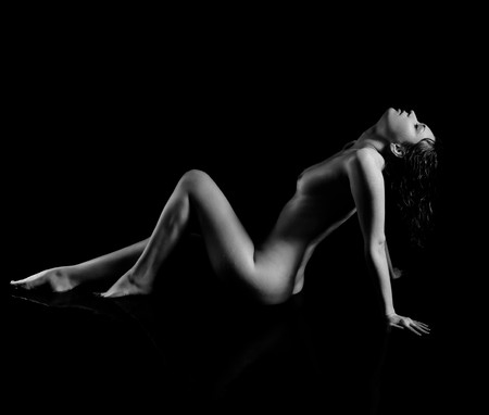 portrait of nude girl posing on black Stock Photo - 7380127