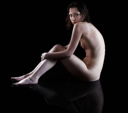 portrait of nude girl posing on black Stock Photo - 7380134