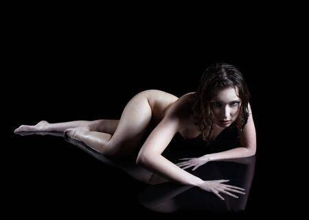 portrait of nude girl posing on black Stock Photo - 7380133