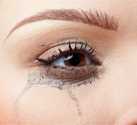 close-up portrait of beautiful crying girl with smeared mascara Stock Photo - 7419212