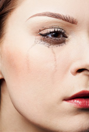 close-up portrait of beautiful crying girl with smeared mascara Stock Photo - 7419218