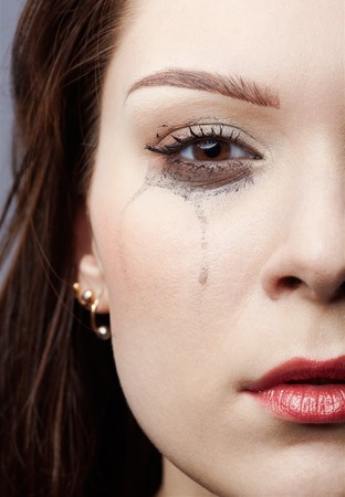 smeared mascara: close-up portrait of beautiful crying girl with smeared mascara Stock Photo