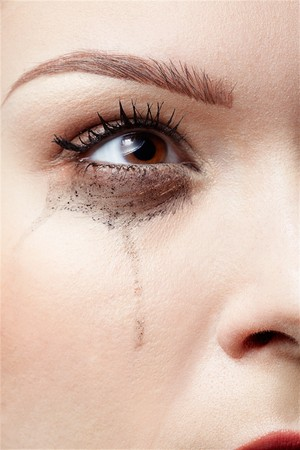 close-up portrait of beautiful crying girl with smeared mascara Stock Photo - 7419219