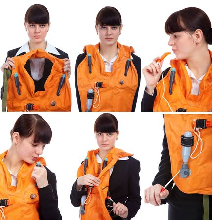 life jacket: portrait of pretty slavonic girl in stewardess uniform showing safety instructions with air-jacket