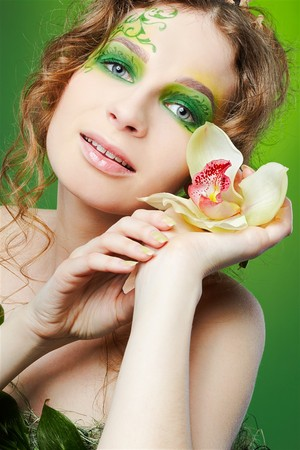 portrait of beautiful girl with fairy theme bodyart posing with lily flower Stock Photo - 7468655